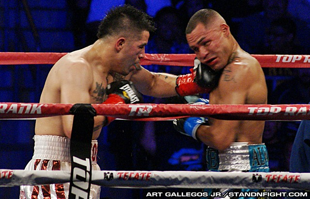 Rios lands a left hook to the chin of Alvarado