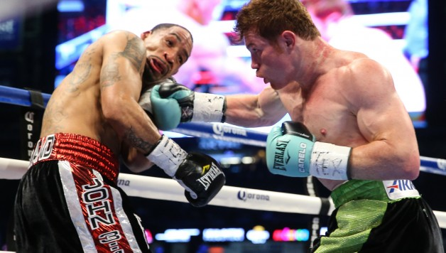 "HOUSTON, TX - MAY 9: Saul ""Canelo"" Alvarez (black/green trunks) and James Kirkland (black/red trunks) during their 12 round super welterweight fight at Minute Maid Park on May  9, 2015 in Houston, Texas. (Photo by Ed Mulholland/Golden Boy/Golden Boy via Getty Images) *** Local Caption ***Saul Alvarez; James Kirkland"